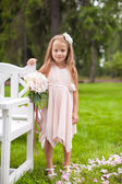 Adorable little girl at a wedding ceremony — Stock Photo