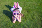 Adorable little girl in Happy Birthday glasses smiling outdoor — Stock Photo