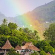 Stock Photo: Rainbow over tropical island and luxurious hotel in Seyshelles