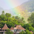 Stock Photo: Rainbow over tropical island and luxurious hotel