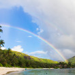 Stock Photo: Rainbow over tropical island and white beach at Seychelles