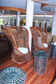 Large wicker chairs in the lobby — Stock Photo