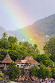 Rainbow over tropical island and luxurious hotel in Seyshelles — Stock Photo