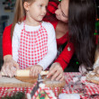 Happy family baking Christmas gingerbread cookies together — Stock Photo #37424089