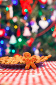 Gingerbread man background Christmas tree lights — Stock Photo