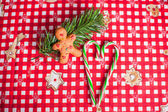 Gingerbread man and sweet candy on bright table — Stock Photo