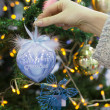 Colorful decorations and balls First Christmas on the branches of fir — Stock Photo