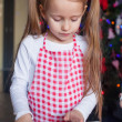 Little happy girl with rolling pin baking gingerbread cookies for Christmas — Stock Photo