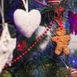 Gingerbread man in the christmas tree — Stock Photo #37844971