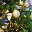 Christmas decorations and balls on the branches of fir — Stock Photo