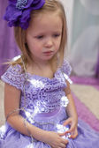 Little adorable girl in beautiful dress among garlands at home — Foto Stock