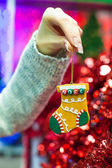 Beautiful decorations on the Christmas tree in female hands — Stock fotografie
