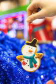 Beautiful decorations on the Christmas tree in female hands — Foto Stock