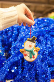 Beautiful decorations on the Christmas tree in female hands — Foto de Stock