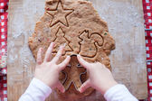Child hands making from dough gingerbread man for Christmas — Foto de Stock