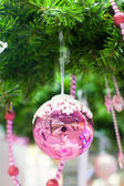 Beautiful shiny pink ball on the Christmas tree — Foto de Stock