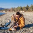 Young father holding little daughter kissing him at beach in sunny day — Stock Photo
