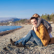 Adorable girl hugging his young father at the beach — Stock Photo