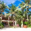 Cozy little hotel on tropical exotic resort at white sandy beach — Stock Photo #39592299