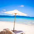 Two chairs and umbrella on stunning tropical beach — Stock Photo #39593315