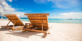 Beach wooden chairs for vacations and summer getaways in Boracay — Stock Photo