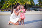 Little girl and young mther on tropical white beach in Boracay — Stock Photo