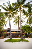 Cozy little hotel on a tropical exotic resort at white sandy beach — Stock Photo