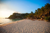 Tropical beach at sunset on an exotic island — Stock Photo