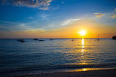 Colorful beautiful sunset with sailboat on the horizon in Boracay island — Stock Photo