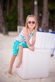 Portrait little adorable girl on a tropical white beach — Stock Photo