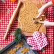 Hands making from dough Christmas gingerbread man — Stock Photo