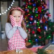 Adorable little girl baking Christmas gingerbread cookies — Stock Photo