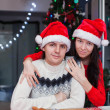 Portrait of young happy couple baking Christmas cakes at home — Photo