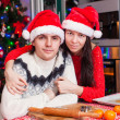 Portrait of young happy couple baking Christmas cakes at home — Stock Photo