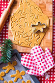 Cutting the gingerbread cookie dough for Christmas and New Year — Stock Photo