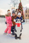 Happy family vacation on skating rink — Stock Photo