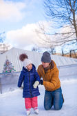 Happy family vacation on skating rink — Stock Photo