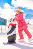 Little happy girl skating on the ice-rink — Stock Photo