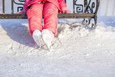 Little skater's legs standing on winter ice rink — Stockfoto