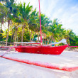 Filipino red boat on white sand beach — Stock Photo #40453079