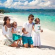 Young family and two kids with word LOVE on tropical vacation — Stock Photo