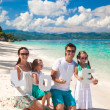 Young happy family and two kids with word LOVE on tropical vacation — Stock Photo #40453405