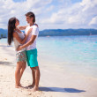 Young couple enjoying each other on exotic beach — Stock Photo