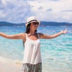 Young woman walking on white sandy beach — Stock Photo