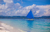 Small boat in open sea on the island of Boracay — Stok fotoğraf