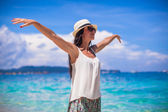 Young beautiful woman enjoying the holiday on white tropical beach — Stock Photo