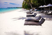 Beach wooden chairs for vacations and relax on tropical white sand plage — Stock Photo