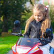 Adorable little girl riding a children's bike — Stock Photo