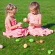 Foto de Stock  : Two adorable little sisters playing with Easter Eggs