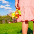 Closeup colorful Easter eggs in the hands of little cute girl — Stock Photo #40575257